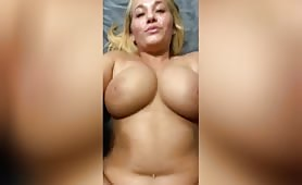 A busty blonde lady lies on her back while a guy fucks her pussy in pov. They have sex in missionary style while her big tits bounce hard.